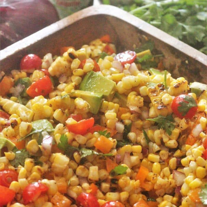 grilled corn salad in a wooden serving dish