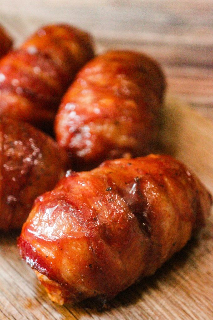 Armadillo Eggs on a wooden cutting board