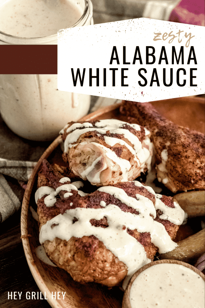 """Alabama white sauce drizzed over grilled chicken. Text overlay: """"Zesty Alabama White Sauce."""""""