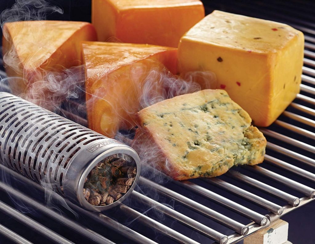 cheese blocks on a grill with a pellet tube.