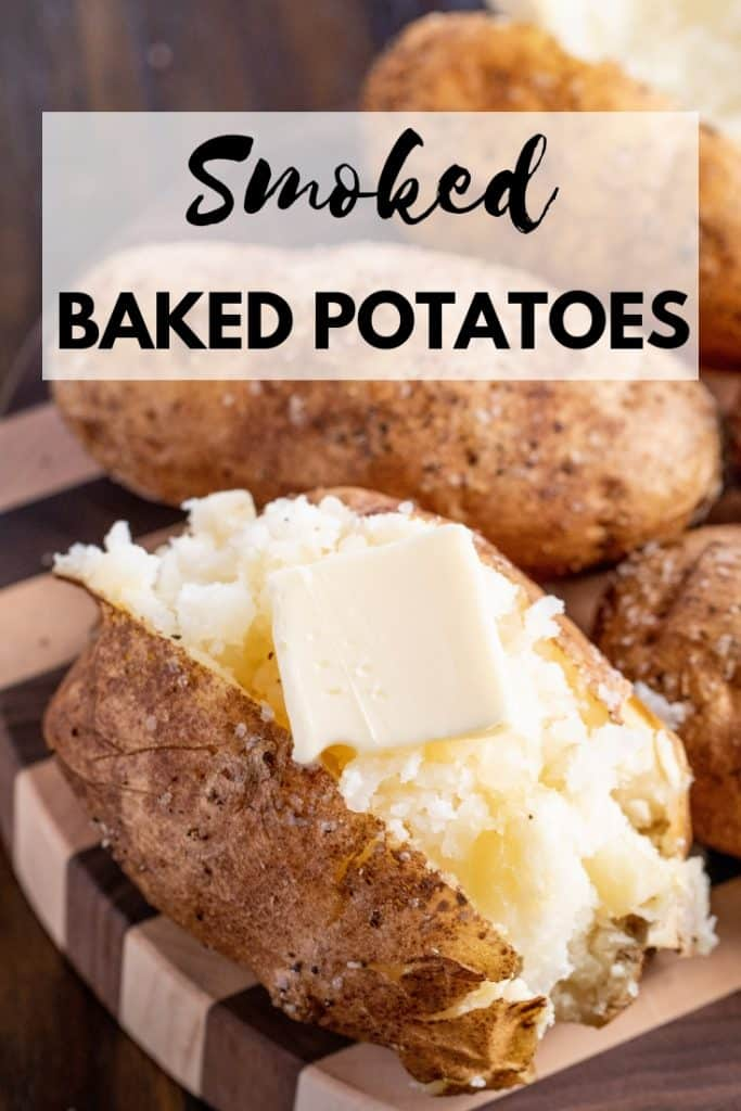 """Smoked Baked Potatoes, sliced open and a pat of butter melting on top. Text overlay reads, """"Smoked Baked Potatoes."""""""