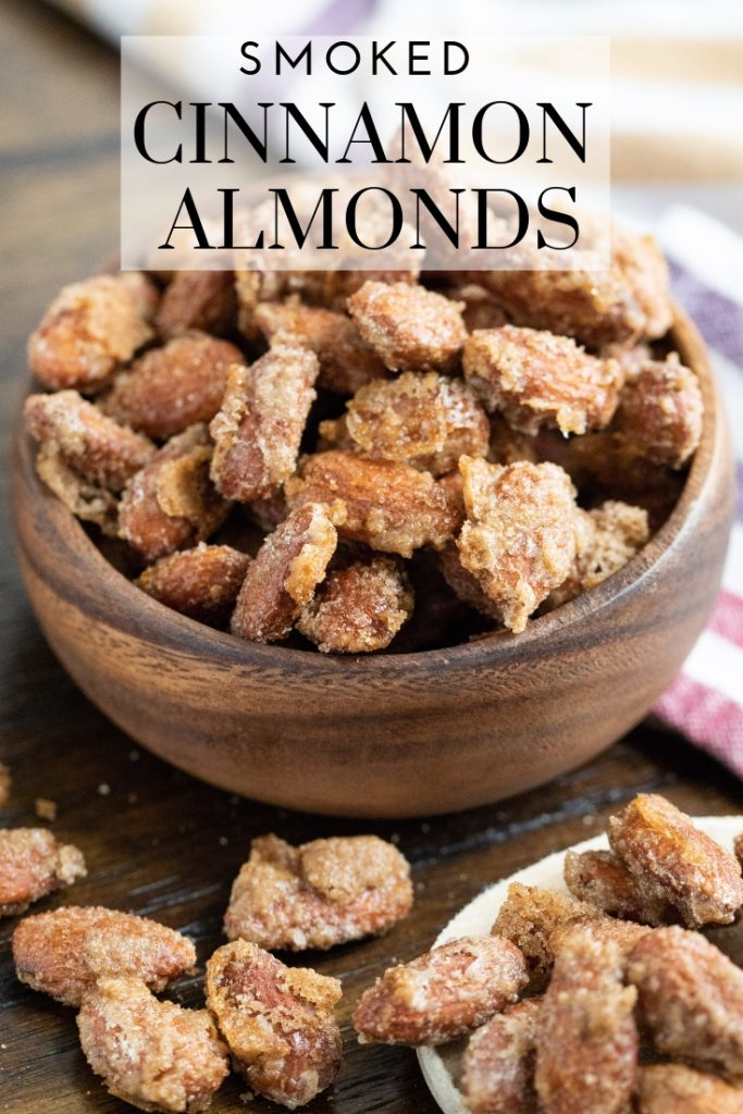 """Smoked Cinnamon Almonds in a wooden bowl. Text overlay reads, """"Smoked Cinnamon Almonds."""""""