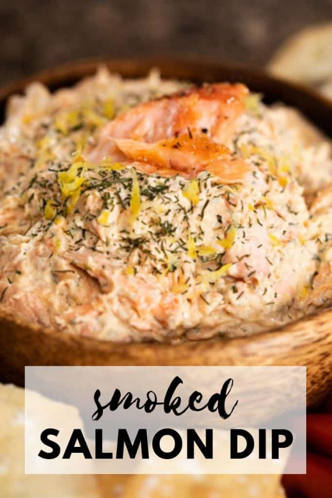 wooden bowl with smoked salmon dip and garnished with flakes of smoked salmon.
