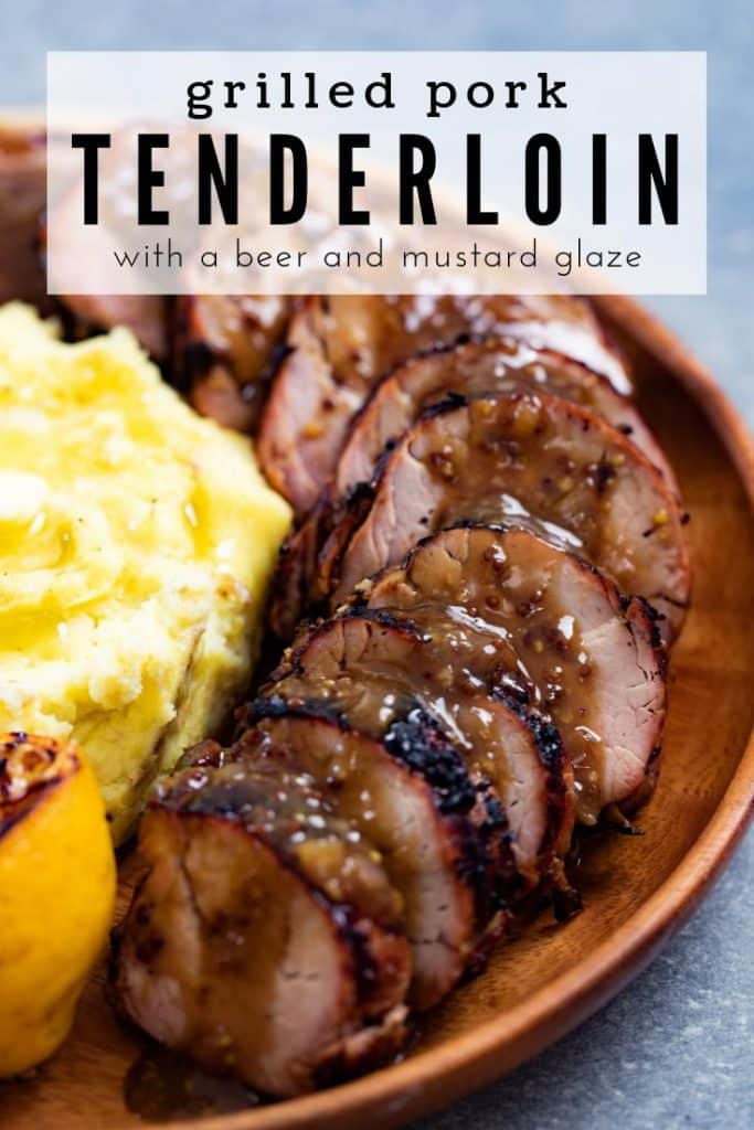 grilled pork tenderloin with beer and mustard glaze on a plate with a side of mashed potatoes.