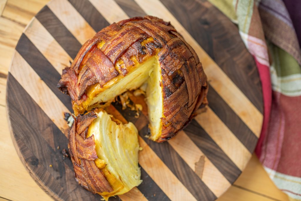 bacon wrapped cabbage on cutting board
