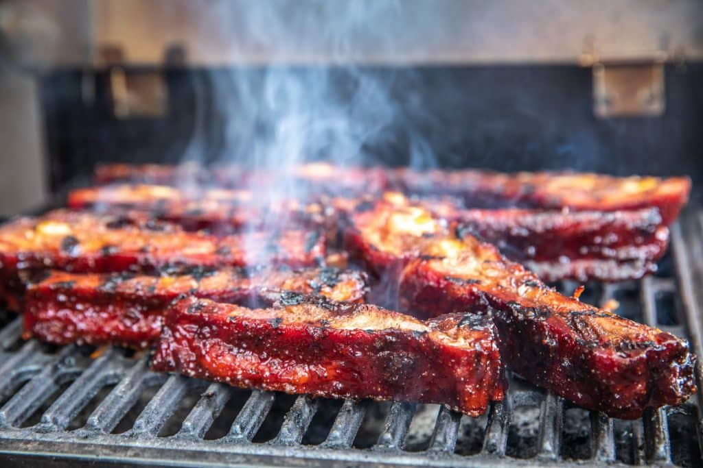 smoky spare ribs on grill.