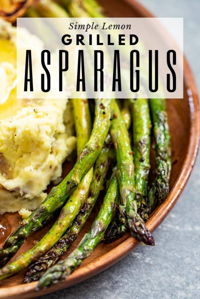 Grilled asparagus on plate with smoked mashed potatoes. Text overlay: Simple Lemon Grilled Asparagus