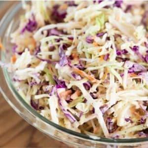 Glass bowl of homemade coleslaw.