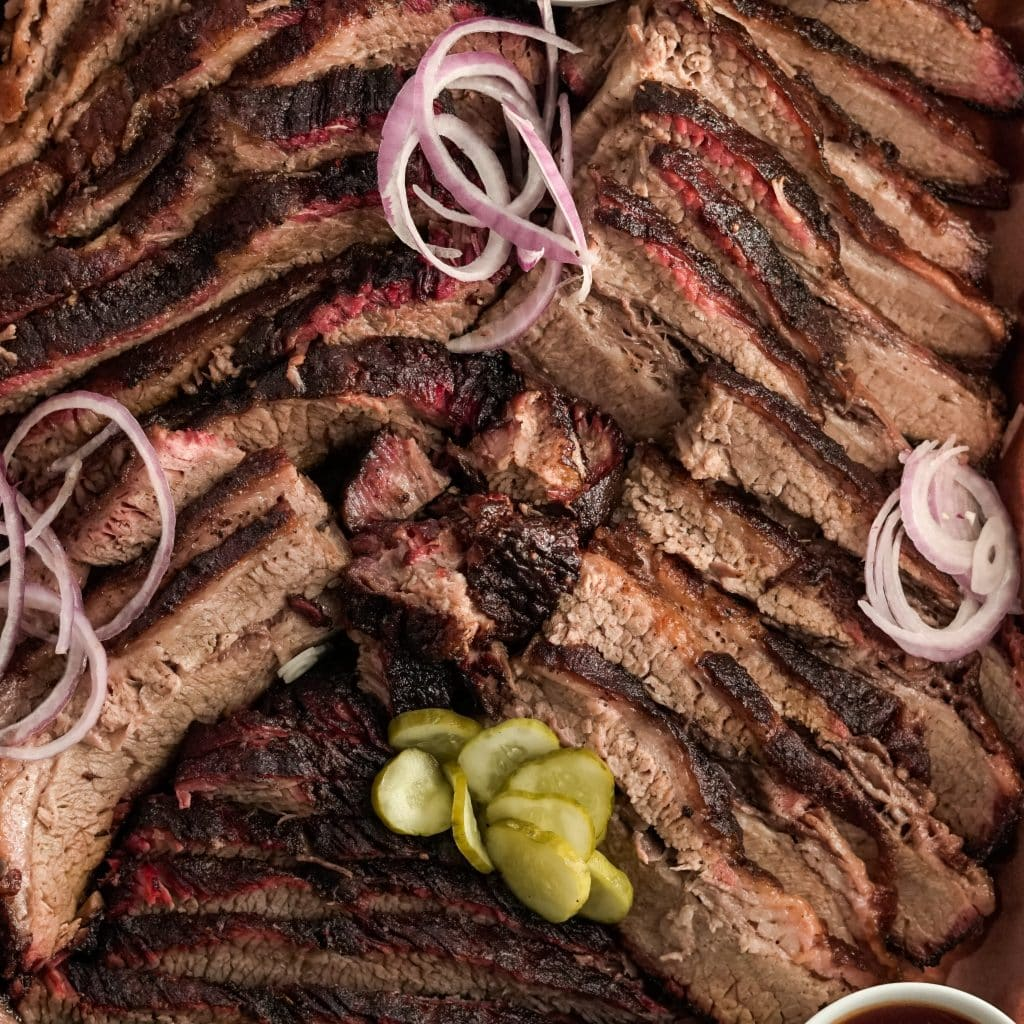 coffee rub brisket with pickled red onions and pickles