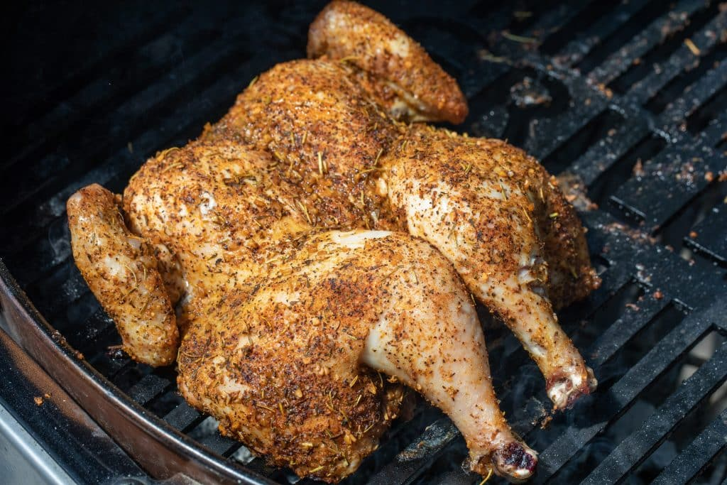 seasoned spatchcock chicken on a grill
