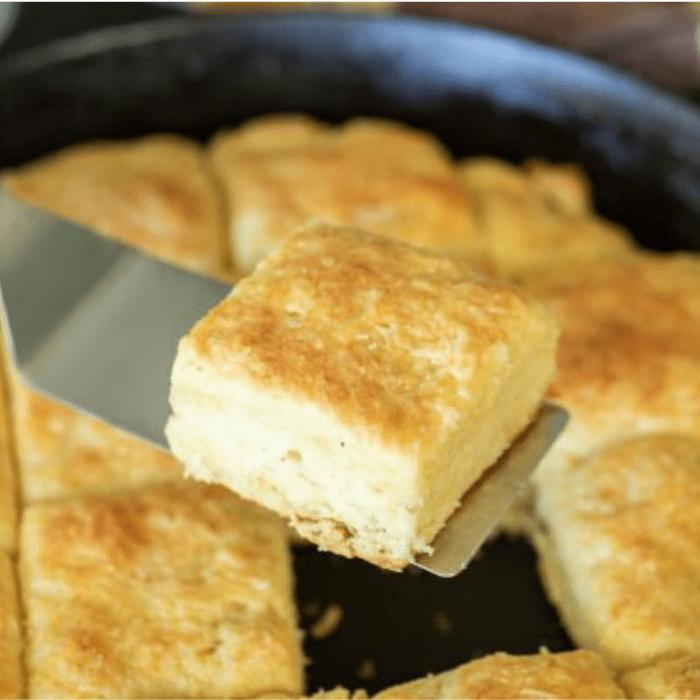square cut biscuits in a cast iron skillet.