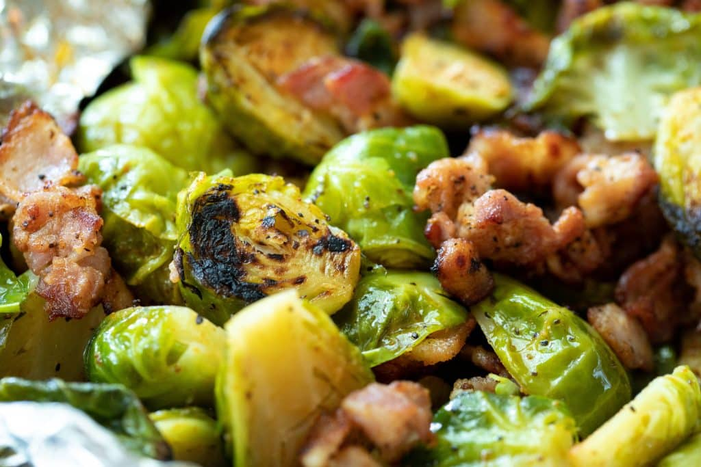 Close up of Grilled Brussels Sprouts with Bacon.