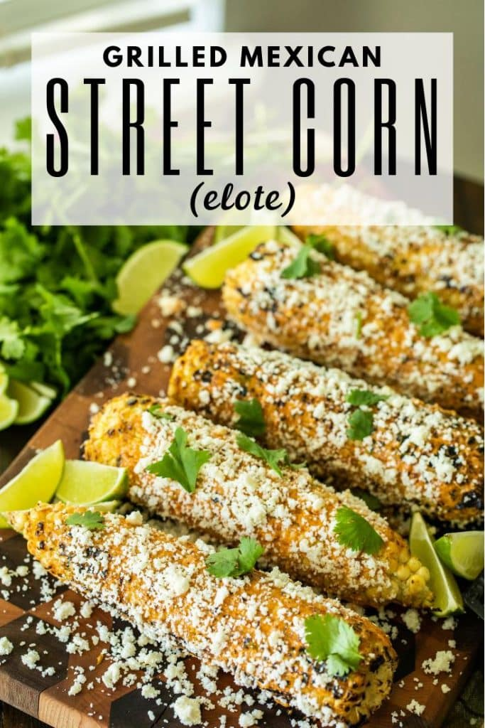 seasoned corn on a cutting board garnished with sliced limes