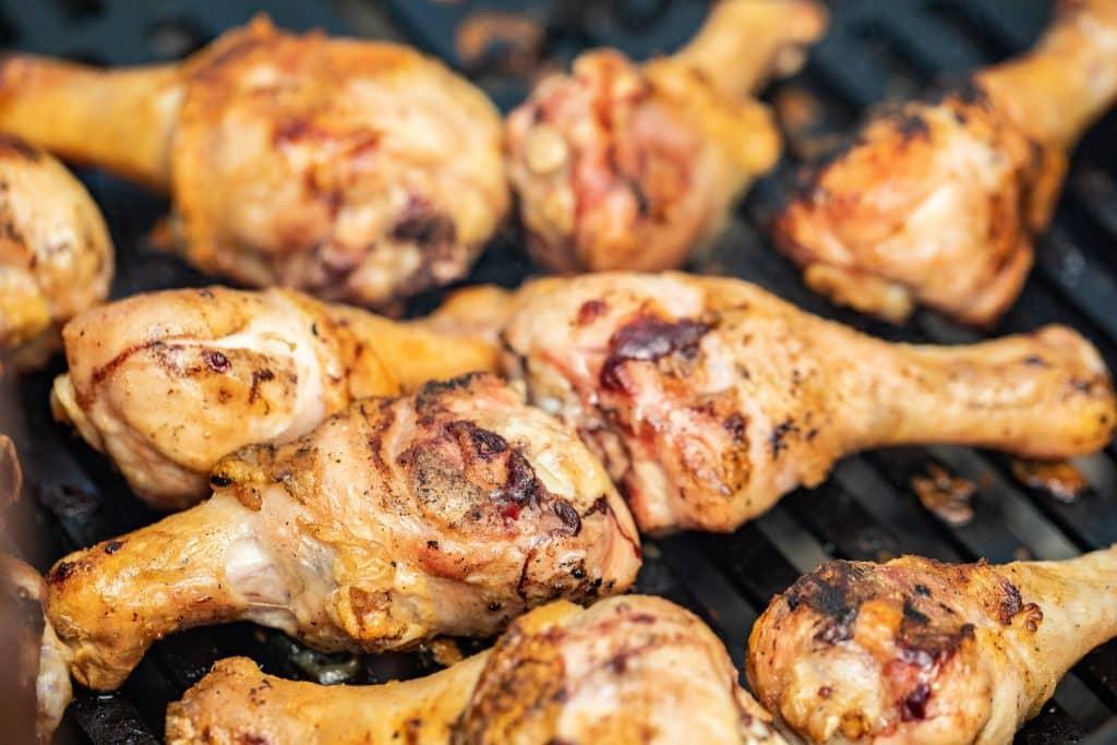 seasoned chicken drumsticks on the grill.