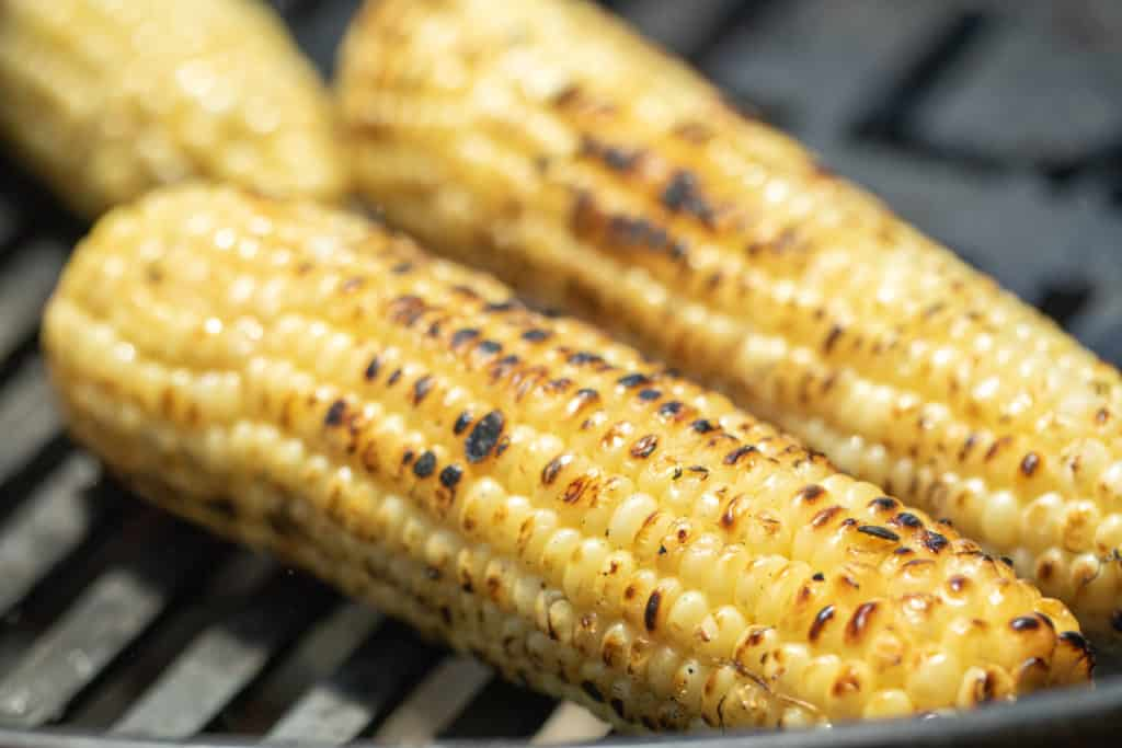 grilled yellow corn on grill grates