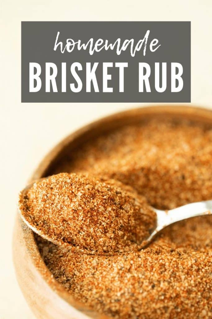 brisket rub in a wooden bowl with a spoon.