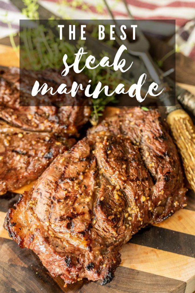 Grilled marinated steak on a cutting board.