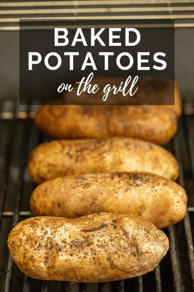 whole baked potatoes on a grill