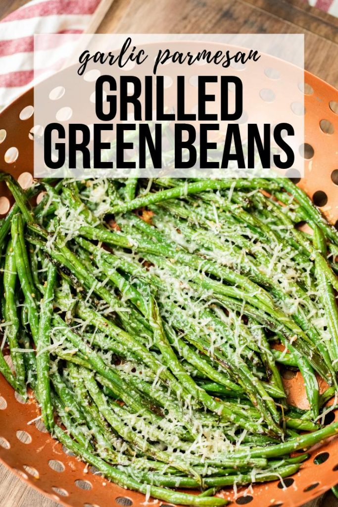 garlic and parmesan seasoned grilled green beans in a cooking basket.