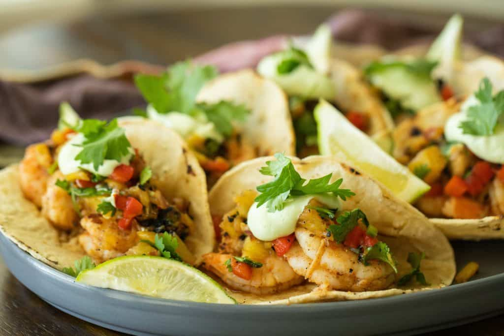 Grilled shrimp tacos on a platter.