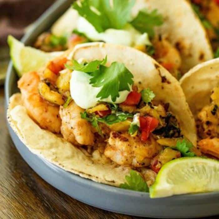 grilled shrimp tacos with pineapple salsa on a serving platter