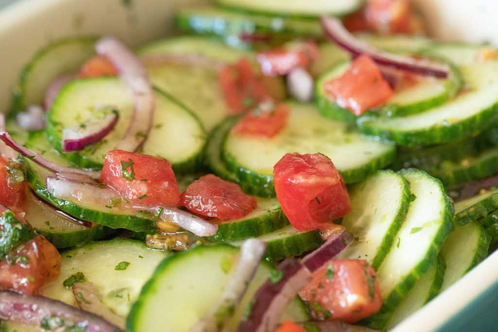 close up of tomato cucumber and onion salad.