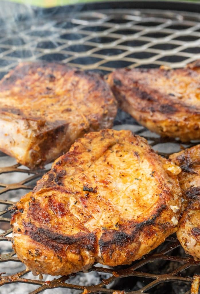 marinated German pork chops on the grill.