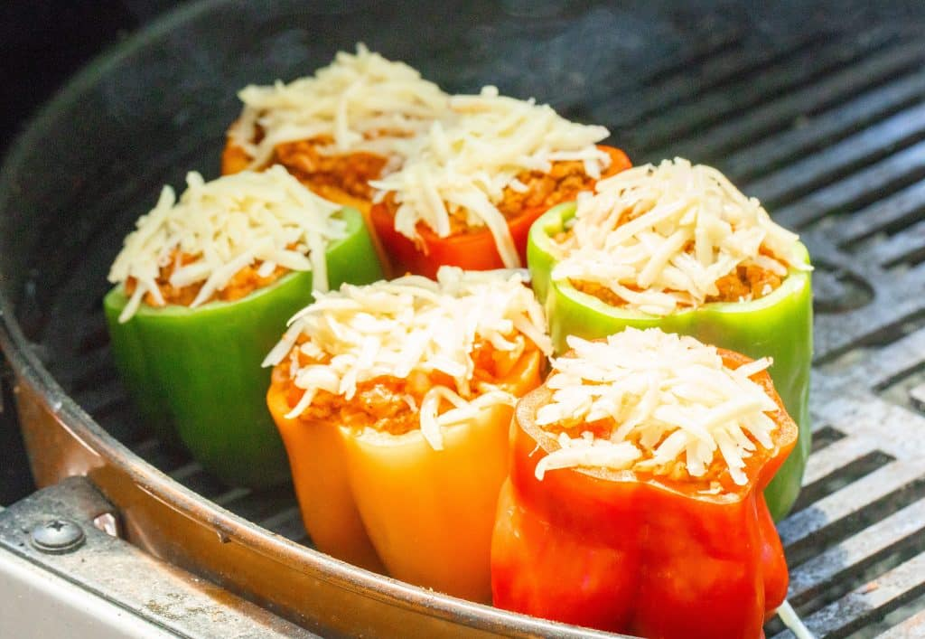 6 stuffed bell peppers on a grill