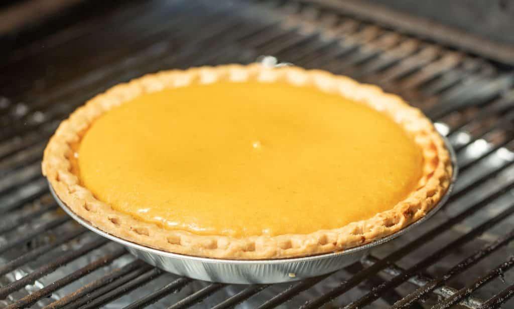 pumpkin pie on grill grates.