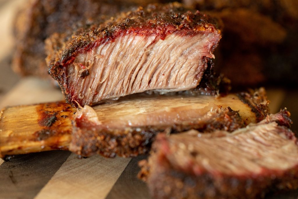 smoked beef short rib meat pulling away from the bone.