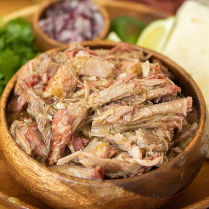 wooden bowl full of smoked chile verde