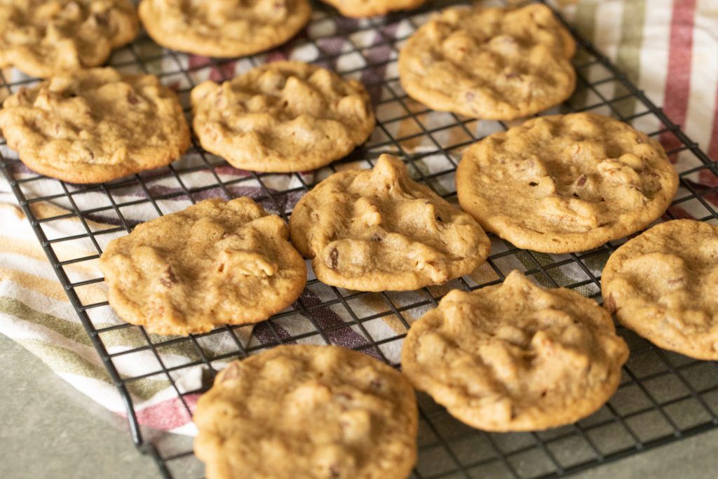 Smoked chocolate chip cookies on a cooling rack.