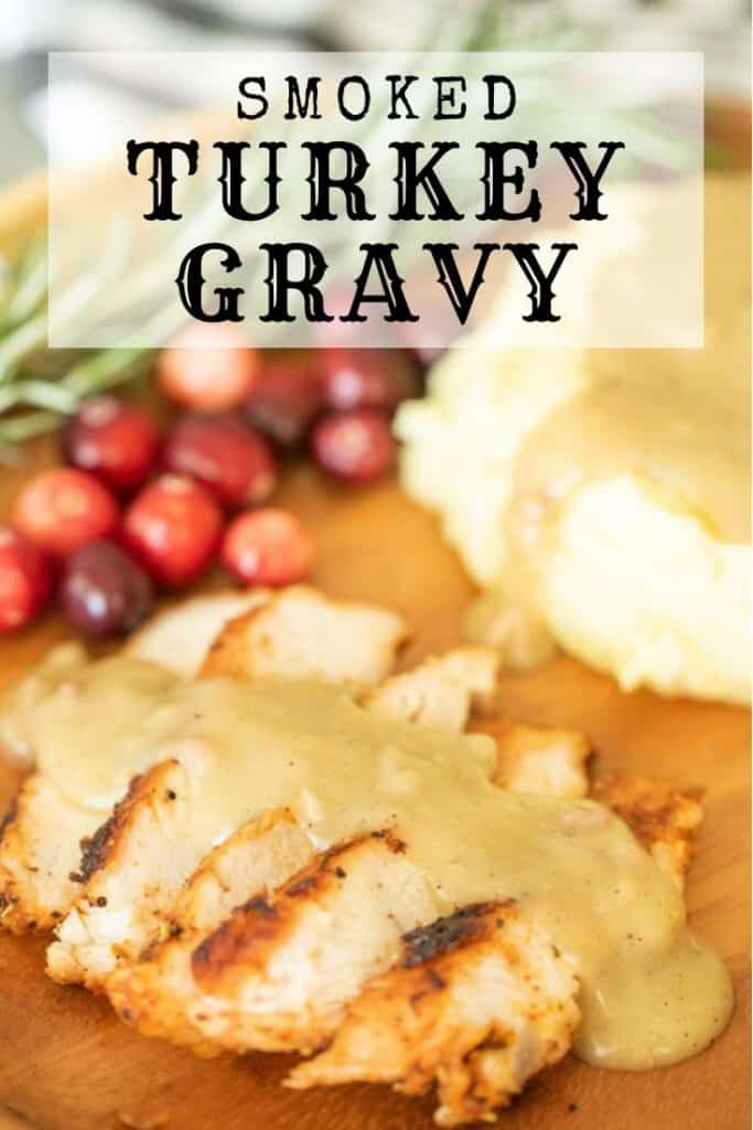 smoked turkey gravy over slices of smoked turkey and mashed potatoes on the side.