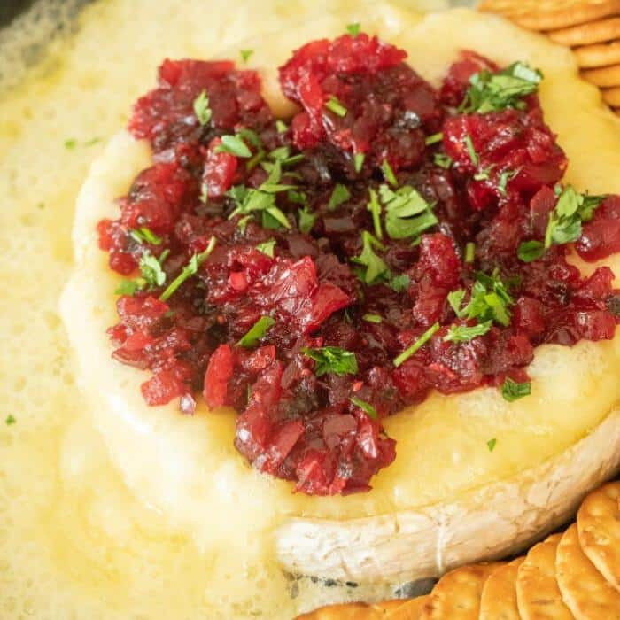 Grilled brie cheese wheel topped with cranberry jalapeno relish.