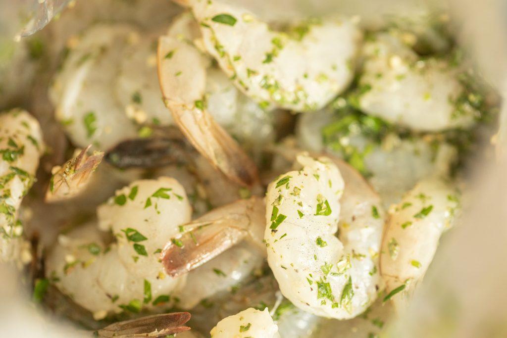 raw shrimp marinating in a shrimp citrus marinade.