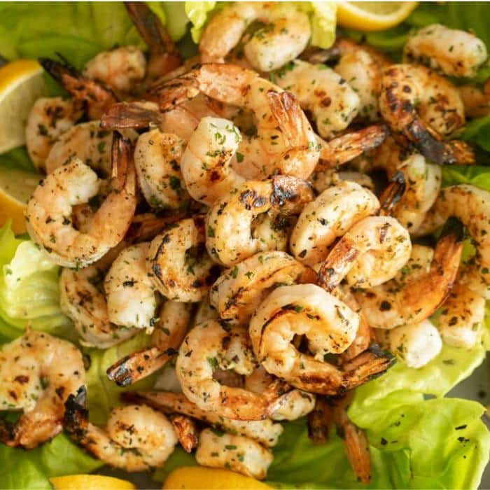 marinated and grilled shrimp on a bed of lettuce