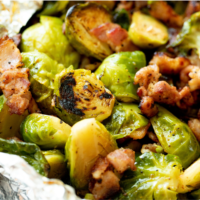Grilled brussels sprouts with bacon pieces