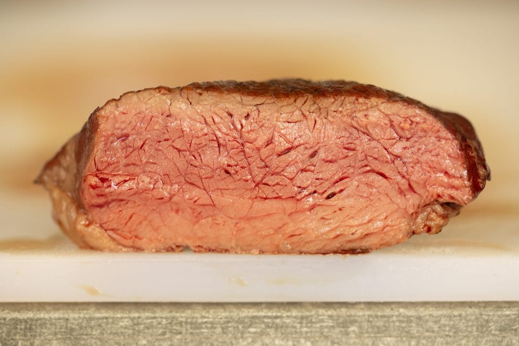 Cross section image of a rare steak.