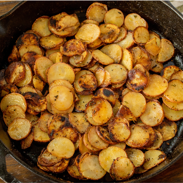 cast iron skillet full of cooked skillet potatoes