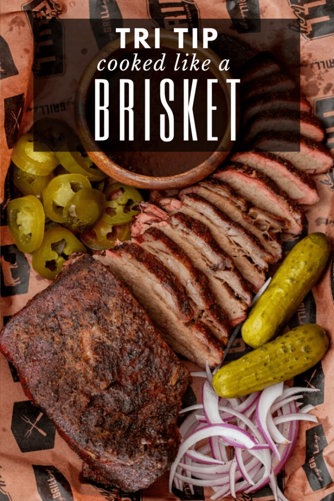 sliced tri tip cooked like a brisket on peach butcher paper surrounded by pickles, jalapenos, and onions.