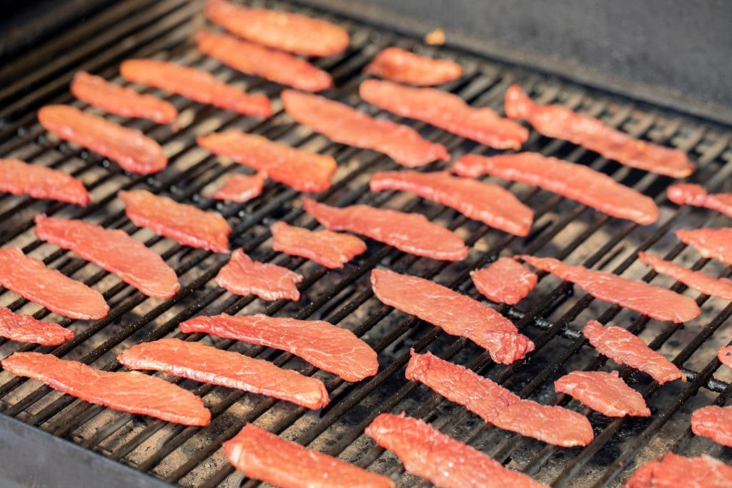 corned beef jerky on a grill.