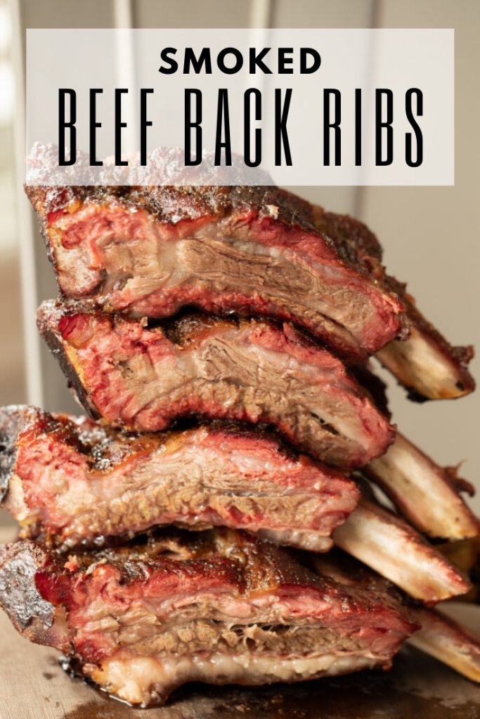 Individually sliced smoked beef back ribs stacked on top of each other with decorative text