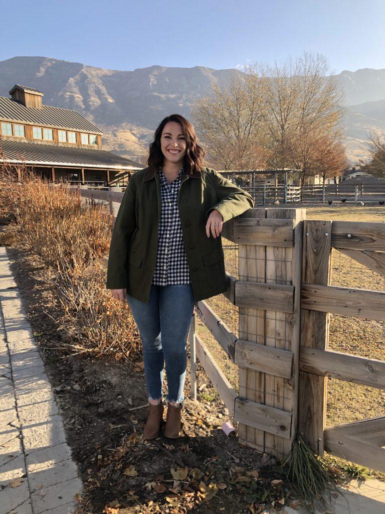 Susie Bulloch poses against a railing on a farm in Pleasant Grove, Utah.