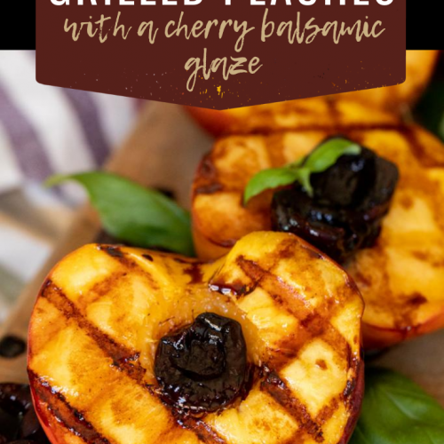 Multiple grilled peach halves with cherries in place of the pits aligned on a wooden cutting board. Text overlay reads: Grilled Peaches with a Cherry Balsamic Glaze.