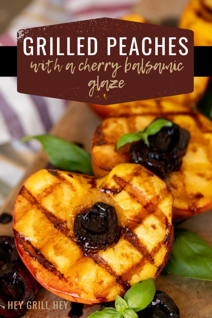 Grilled peaches will grill marks topped with glazed cherries and garnished with mint.