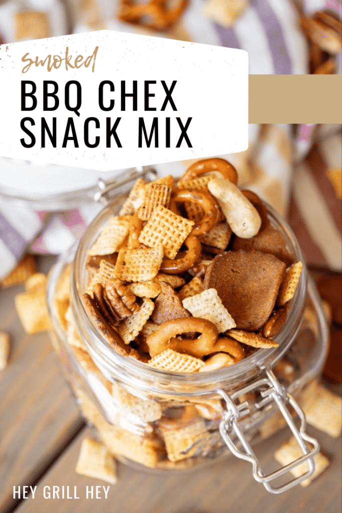 """Smoked Chex mix in a hinged mason jar with text overlay: """"Smoked BBQ Chex Snack Mix"""""""