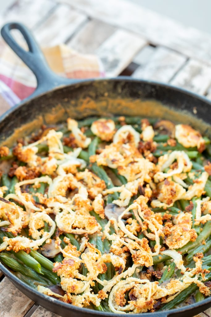 Smoked green bean casserole in a 12-inch case iron skillet.