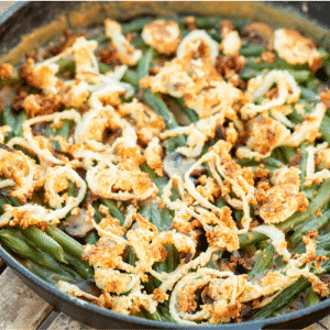 Smoked green bean casserole in a 12-inch cast iron skillet.