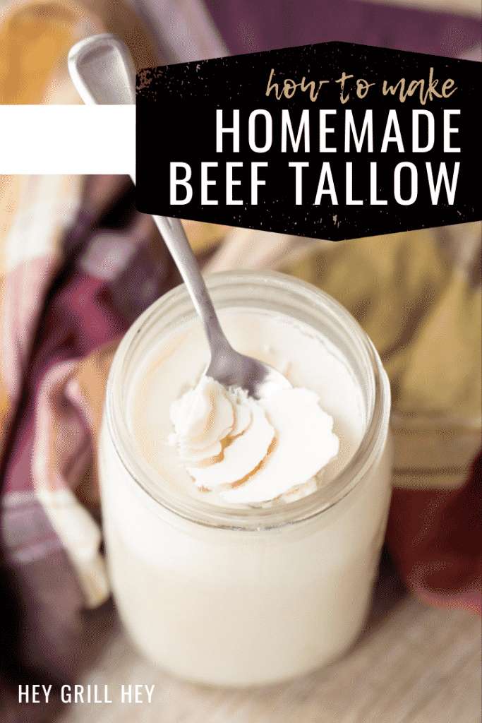 """Spoon sticking out of a glass mason jar of chilled beef tallow next to a plaid towel. Text overlay: """"How to Make Homemade Beef Tallow."""""""