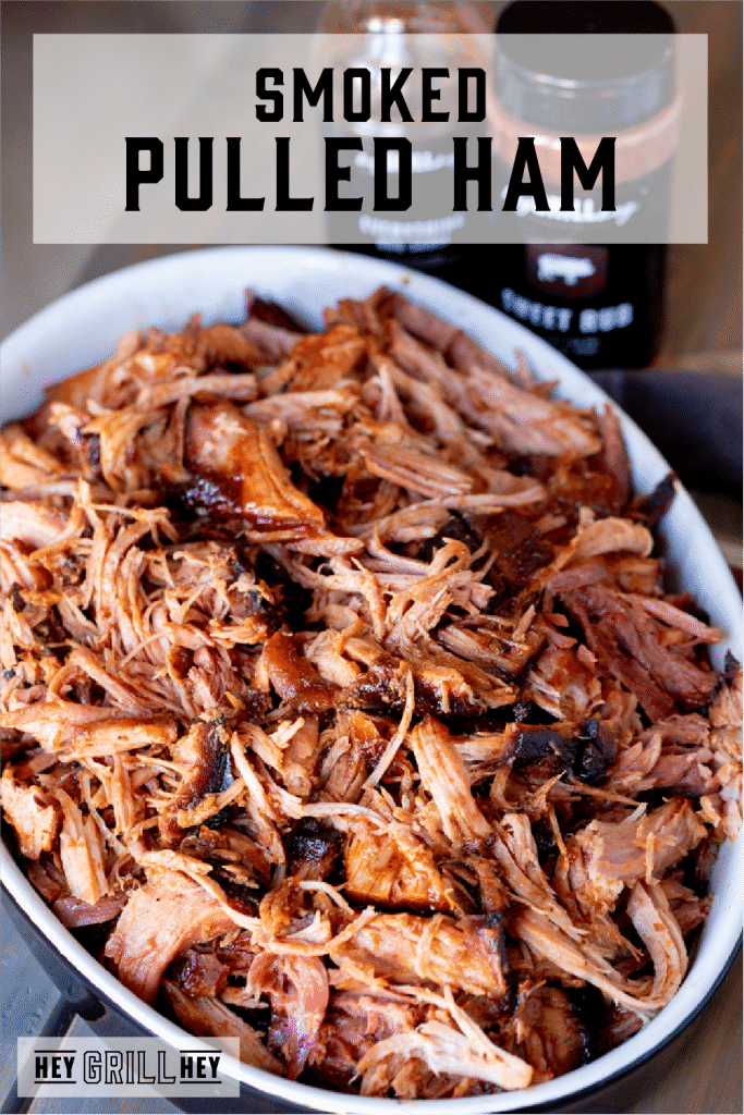 Smoked pulled ham in a white, oval serving dish. Text overlay reads: Smoked Pulled Ham.